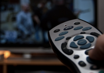 royalty free image of a tv screen and a remote