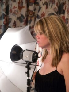blond woman and photographic light fixture